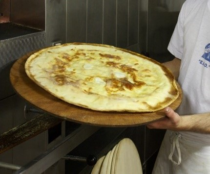 Ligurian cheese focaccia, another of Commissioner Daria Vinci's favorite foods, photo copyright by Alison Harris